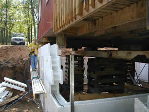 Underpinning an existing home with our insulated poured foundation wall system