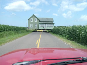 Amery house moving through the country roads
